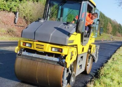 Dynapac CG2300 pivot roller at worksite in Germany, asphalt compacting